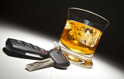 Keys and shot glass illustrating Jacksonville DUI attorney services