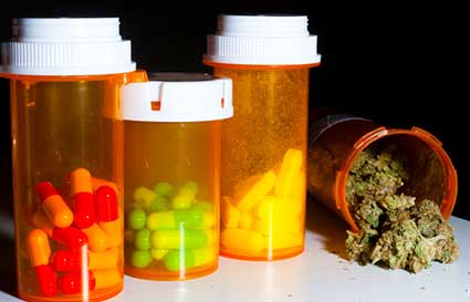 Prescription drugs and marihuana illustrating Jacksonville drug posssession attorney services