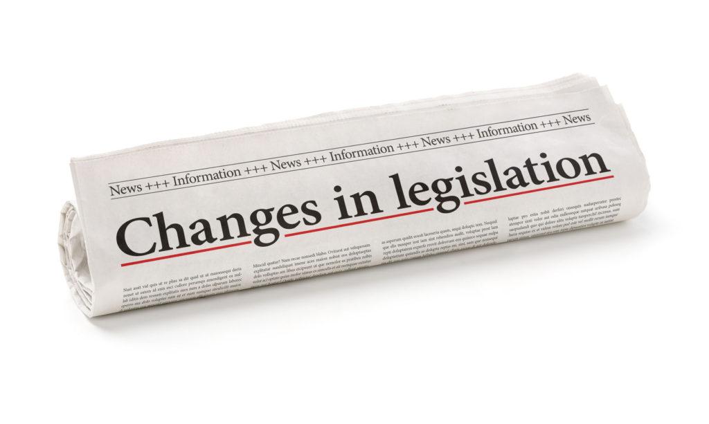 48391881 - rolled newspaper with the headline changes in legislation