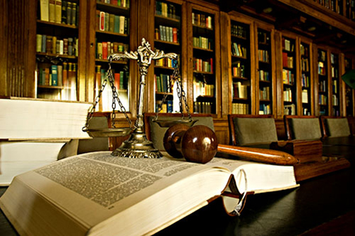 Law book and gavel in legal library