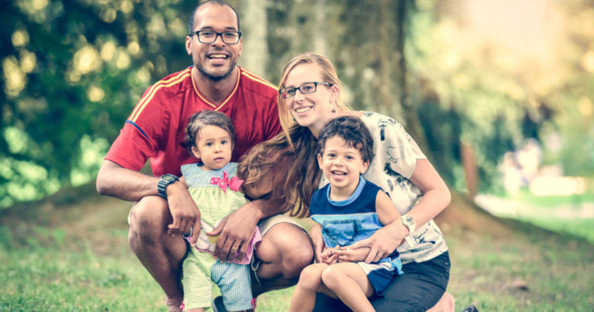 Interracial couple with two children in a park